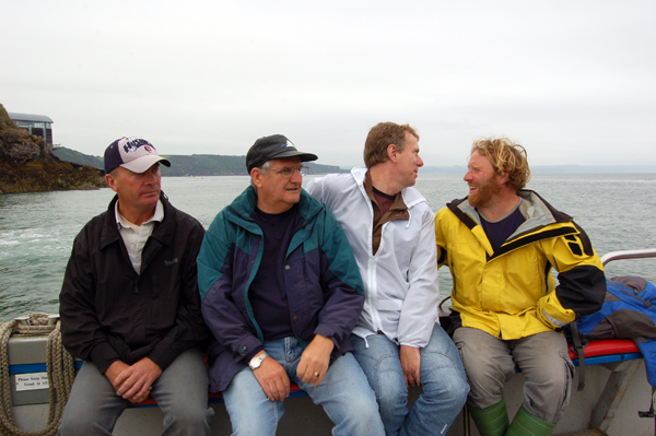 Photo of group members chatting on route to fishing grounds