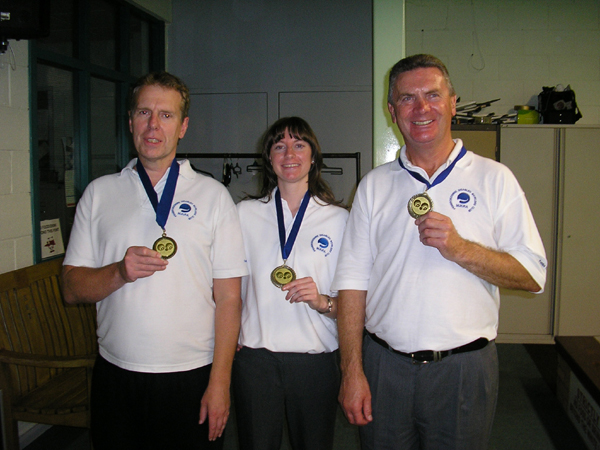 Laurie, Maddie and John holding their bowling championship medals