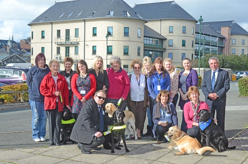 Photo of group of people, some with Guide dogs outside the Picton Centre in Haverfordwest