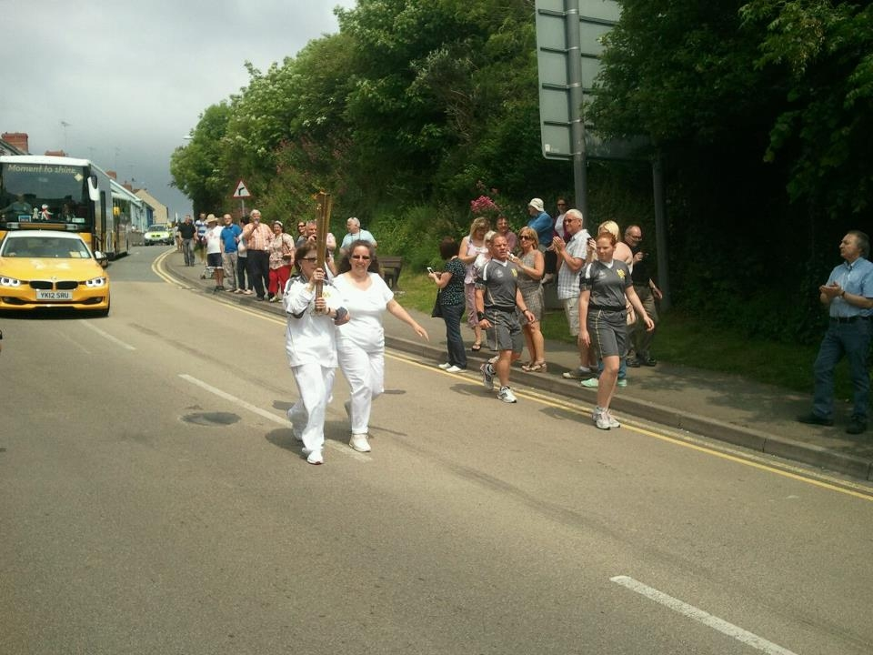 Ann Davies member of St David's VIP group carrying the Olympic Torch
